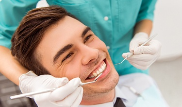 Man receiving dental exam