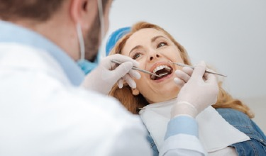 Older woman in dental chair receiving treatment