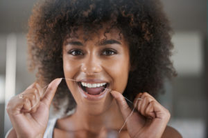 woman flossing happy