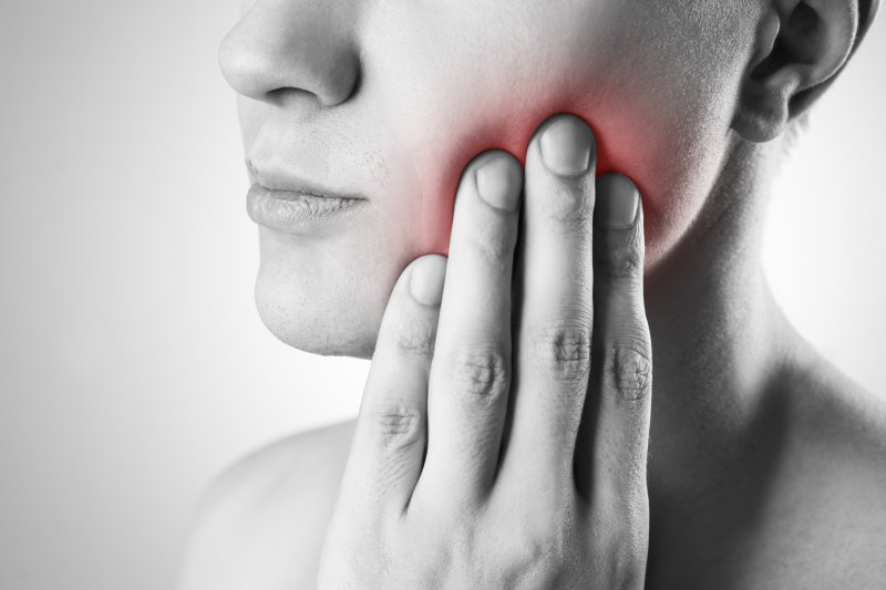 A woman with mouth pain.